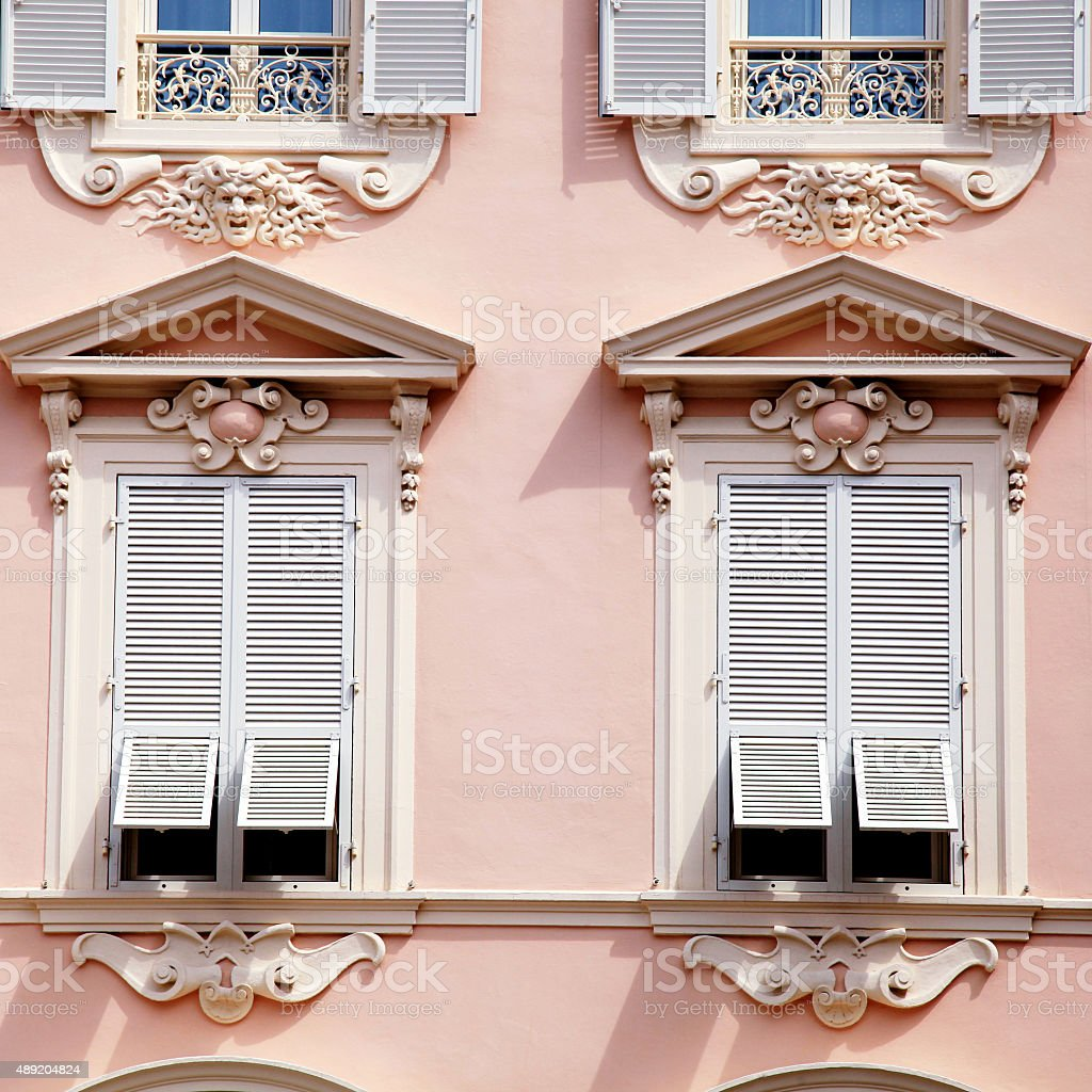 house with old french grey shutter windows in Monaco stock photo