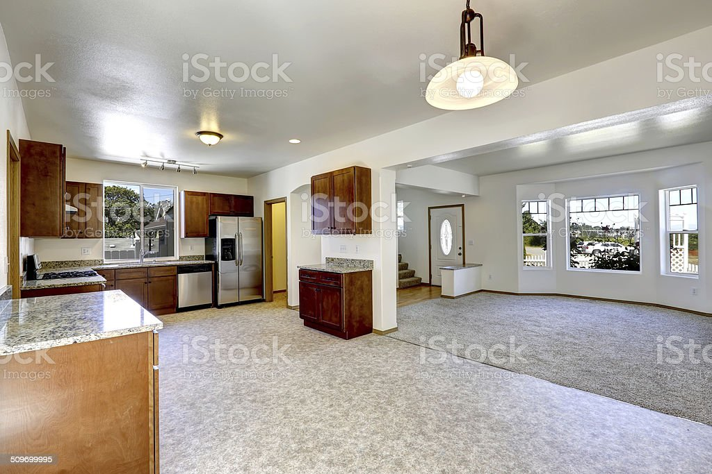 House with open floor plan. Empty living and kitchen room stock photo