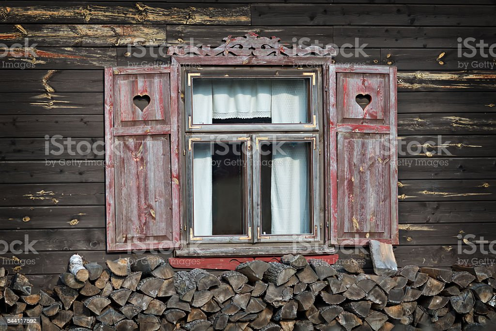 house with opened shutters stock photo