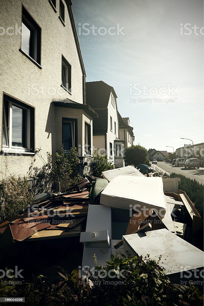 House with rubbish, sky and sun royalty-free stock photo