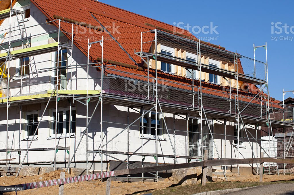 House with scaffolding under construction stock photo