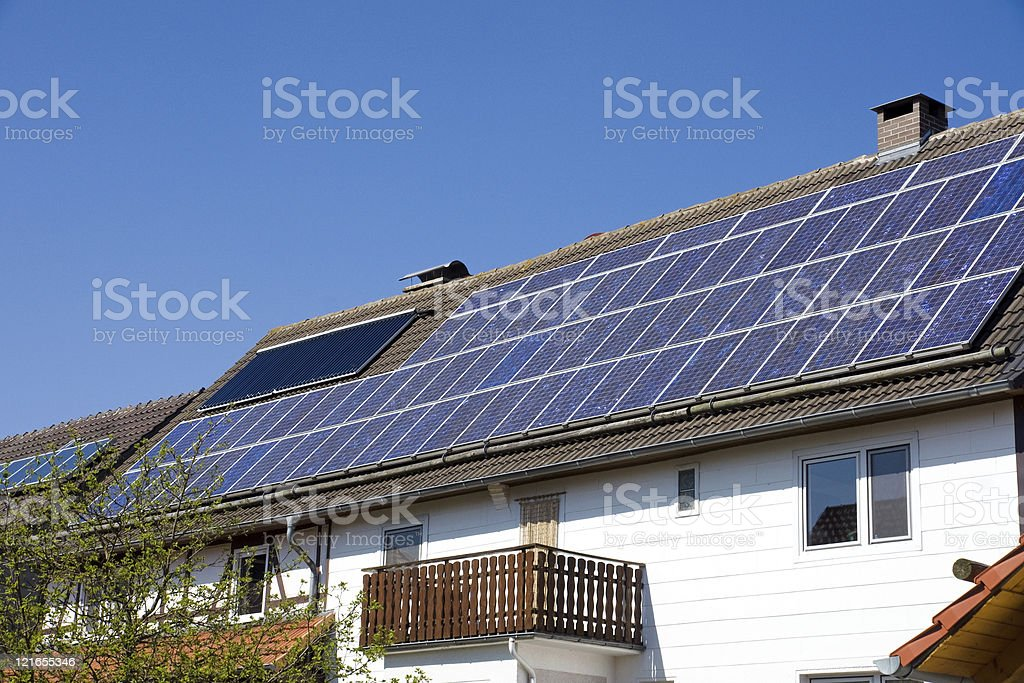 House with solar cells on the roof stock photo