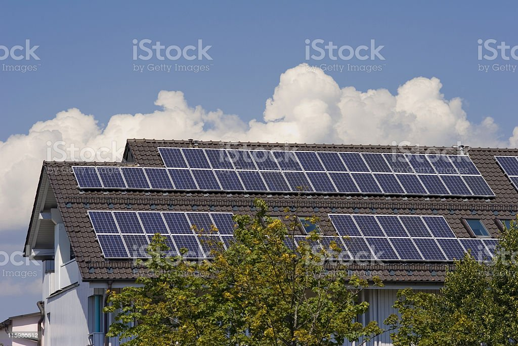 House with solar panels on the roof royalty-free stock photo