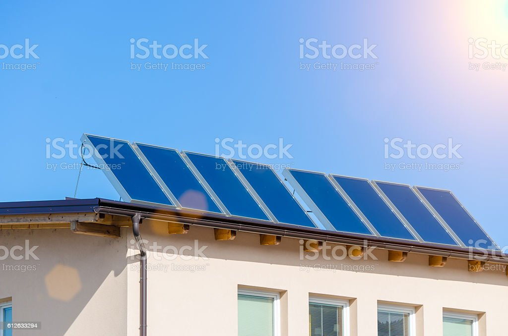 House with solar panels stock photo