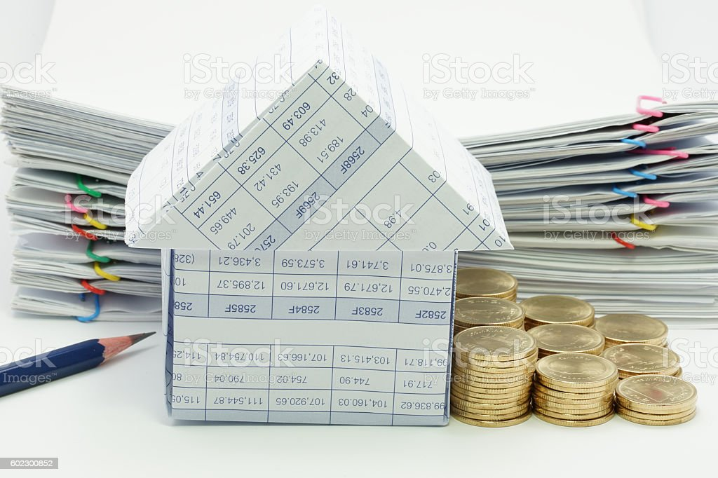 House with step pile of gold coins royalty-free stock photo