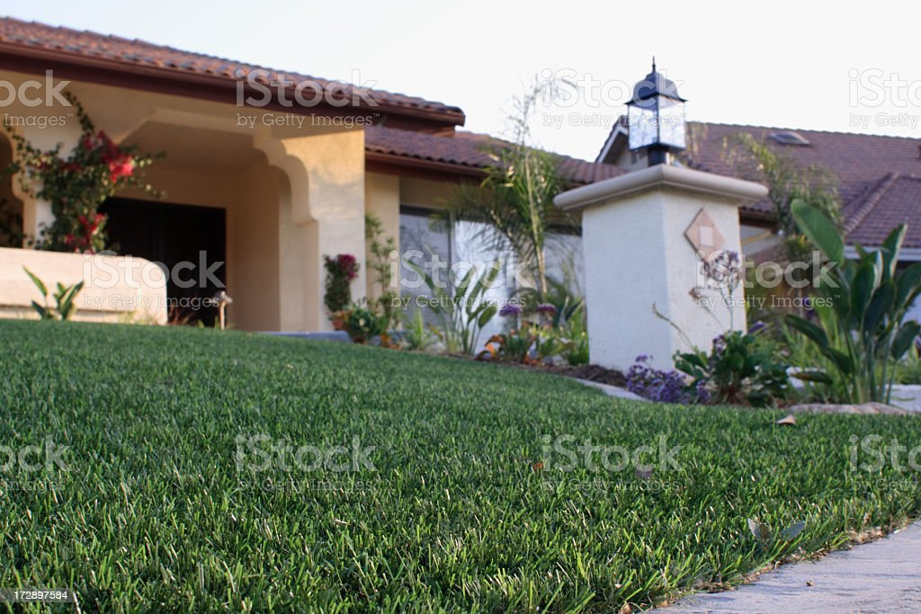 House with Synthetic Lawn stock photo