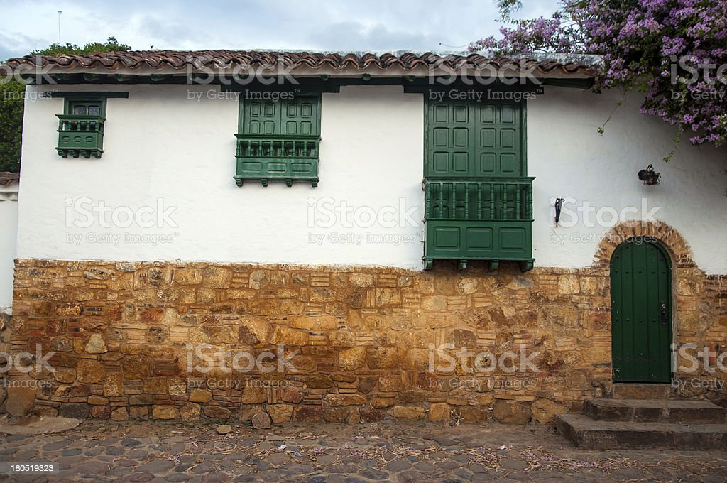 House with Three Different Windows royalty-free stock photo