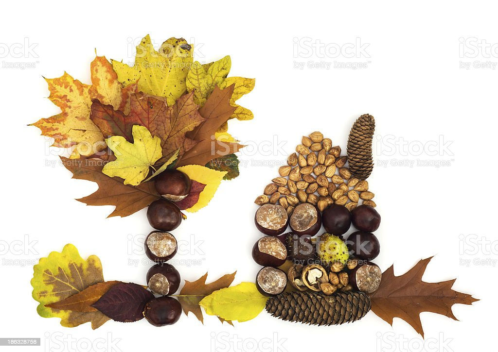 House with tree made of leaves and chestnuts. stock photo