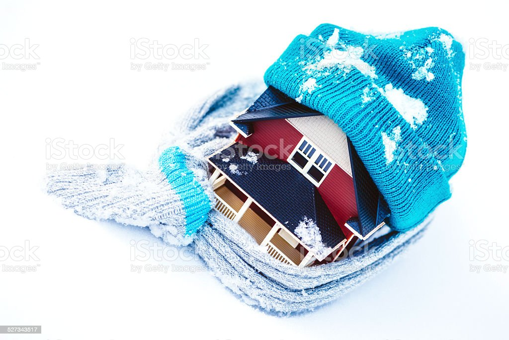 House Wrapped in Winter Clothing; Insulate Your Home stock photo