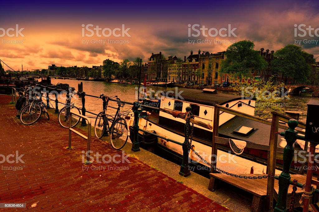 Houseboat and Bicycles in Amsterdam stock photo