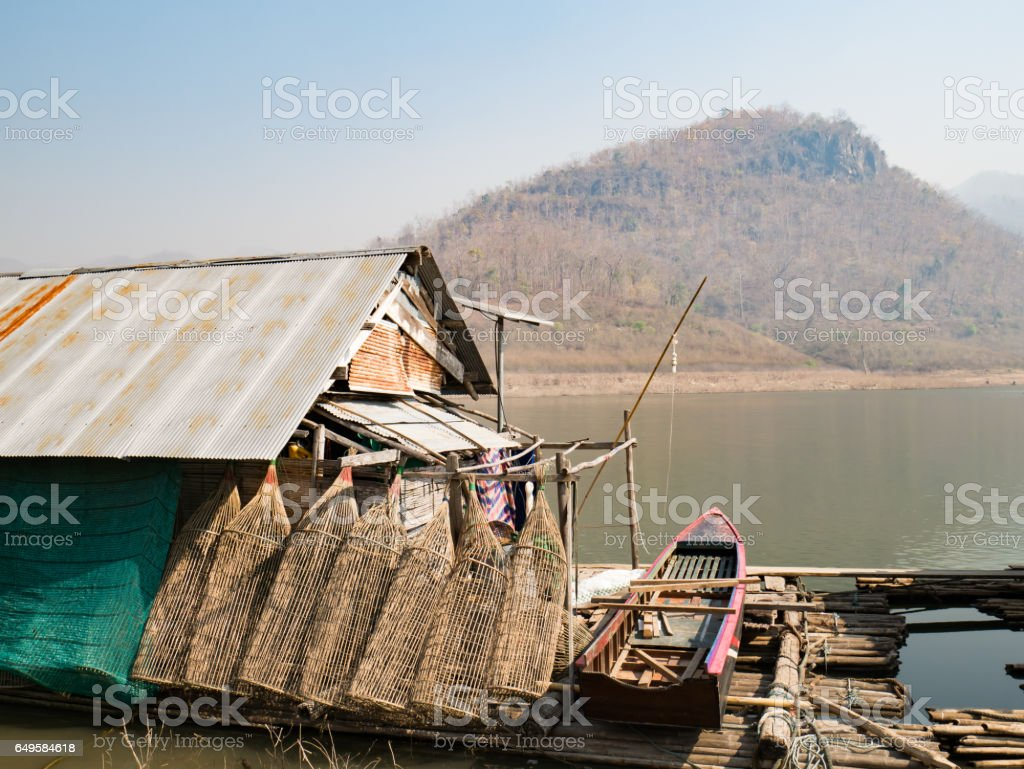 Houseboat and fish trap stock photo