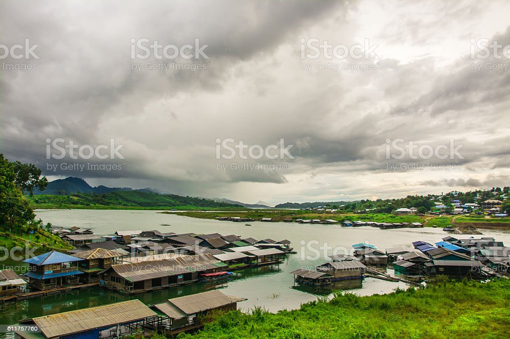 Houseboat and old wooden bridge stock photo