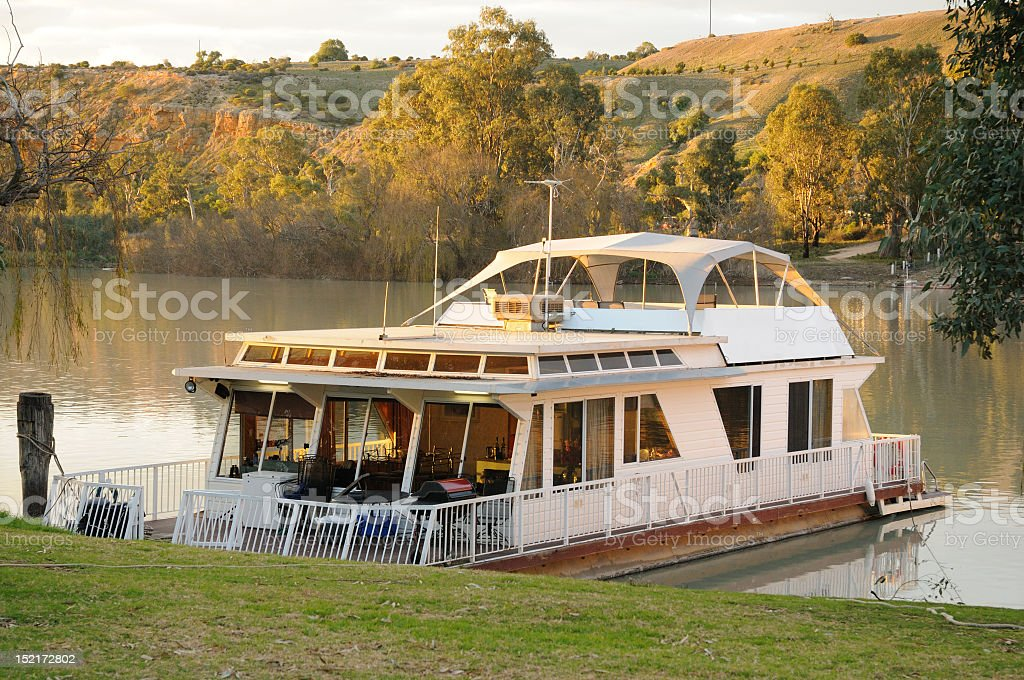 Houseboat at sunset docked on River Murray, South Australia stock photo