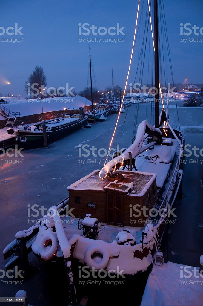 Houseboat covered in snow. stock photo
