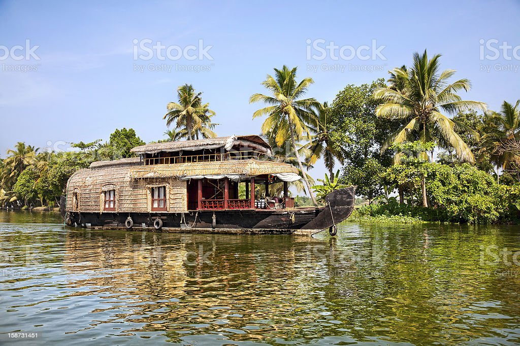 Houseboat floating in the backwaters of a river stock photo