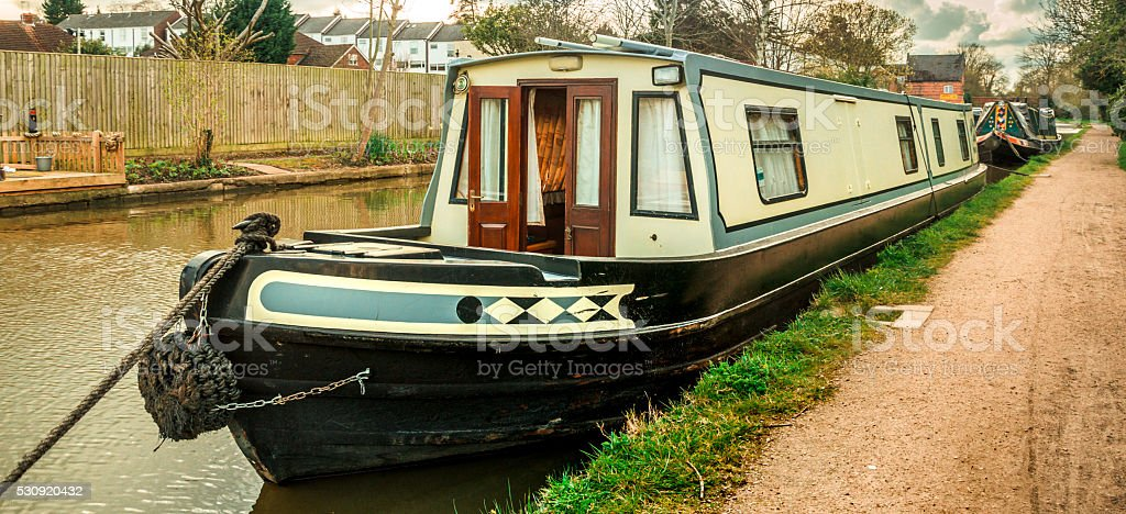 Houseboat - Moored canal boat stock photo