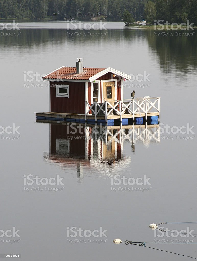 Houseboat on a lake royalty-free stock photo