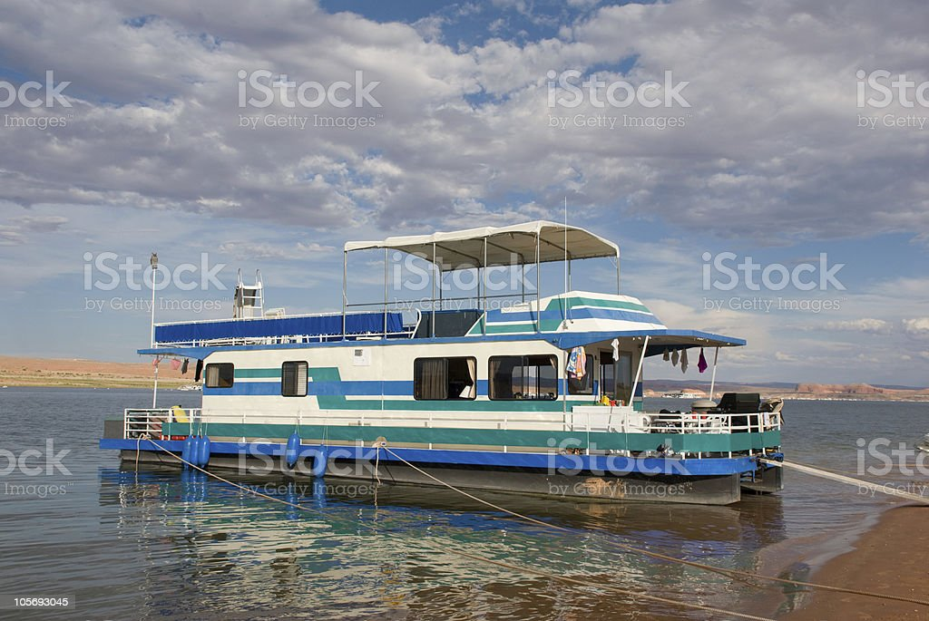 Houseboat on Lake Powell, Utah Anchored on a Sandy Beach royalty-free stock photo