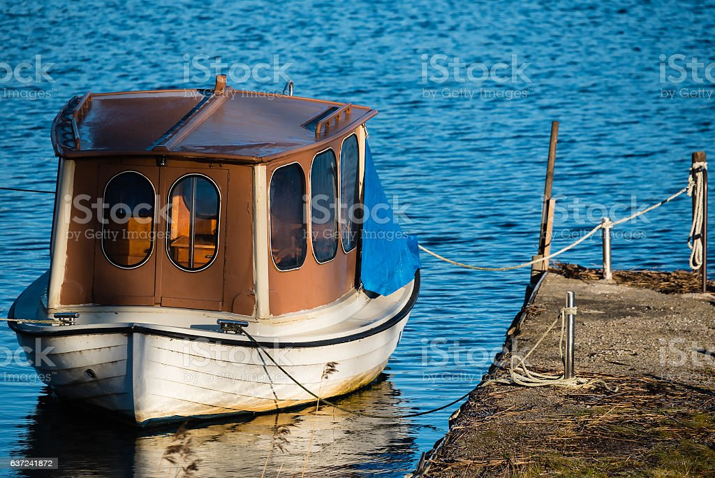 Houseboat or up cycled fishing boat stock photo