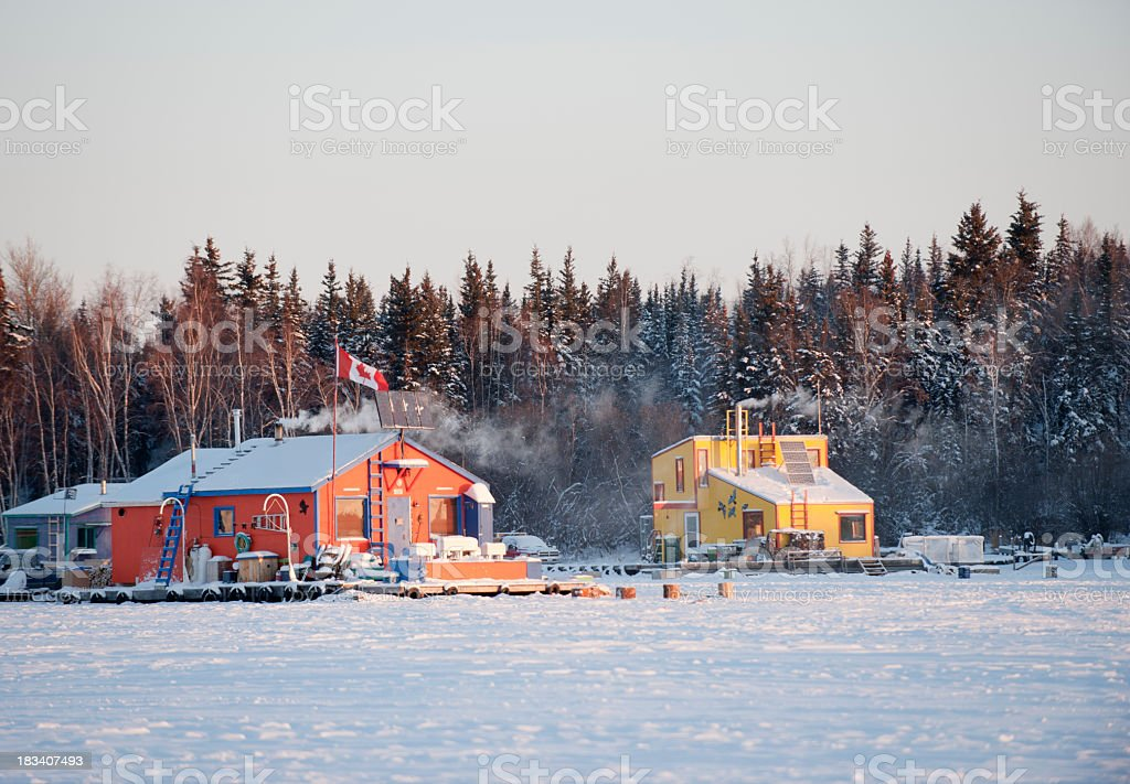 Houseboats Frozen in the Ice. stock photo