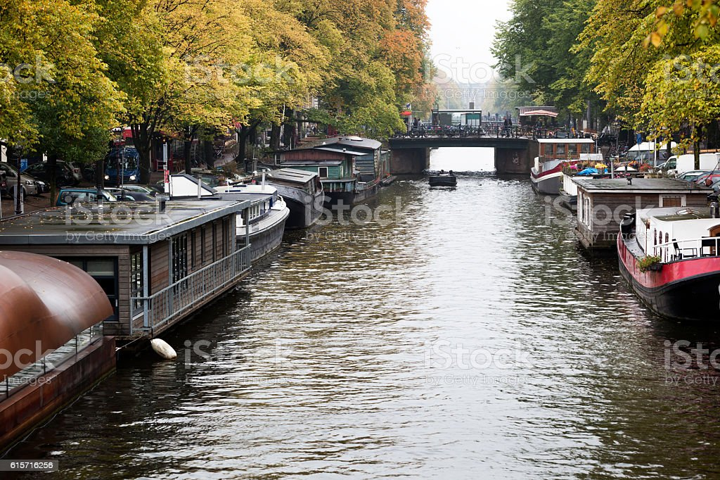 Houseboats in the canals of Amsterdam stock photo