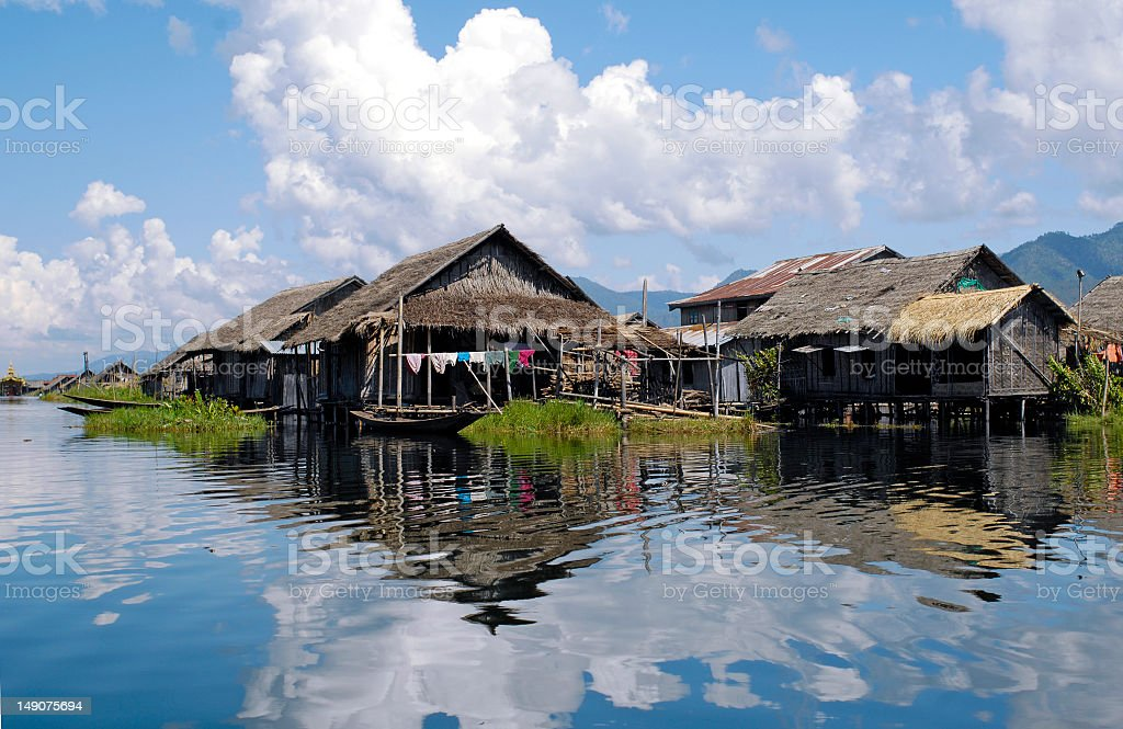 Houseboats on Inle lake in Burma during monsoon season royalty-free stock photo