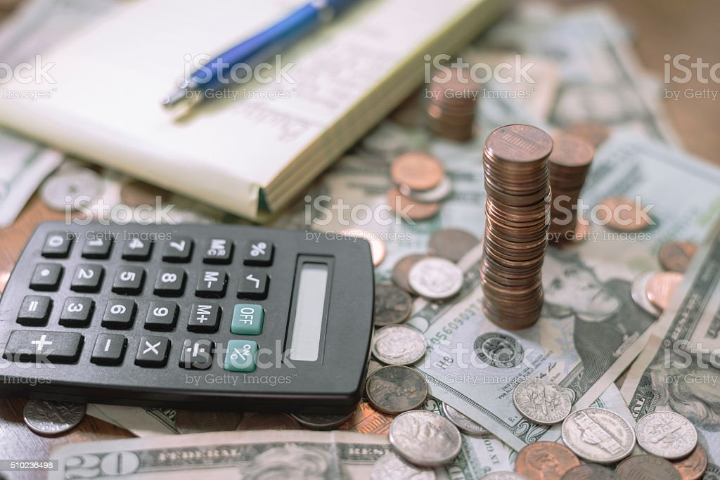 household budget planning workspace with money and calculator stock photo