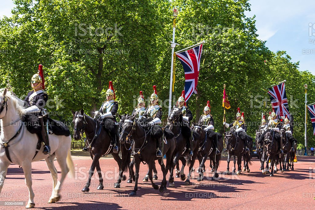 Household Cavalry walk along The Mall in London, England stock photo