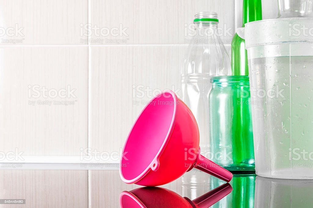 Household funnel for pouring liquids. stock photo