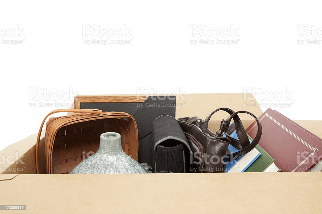 Household Items in Cardboard Box: Relocation or Yard Sale stock photo