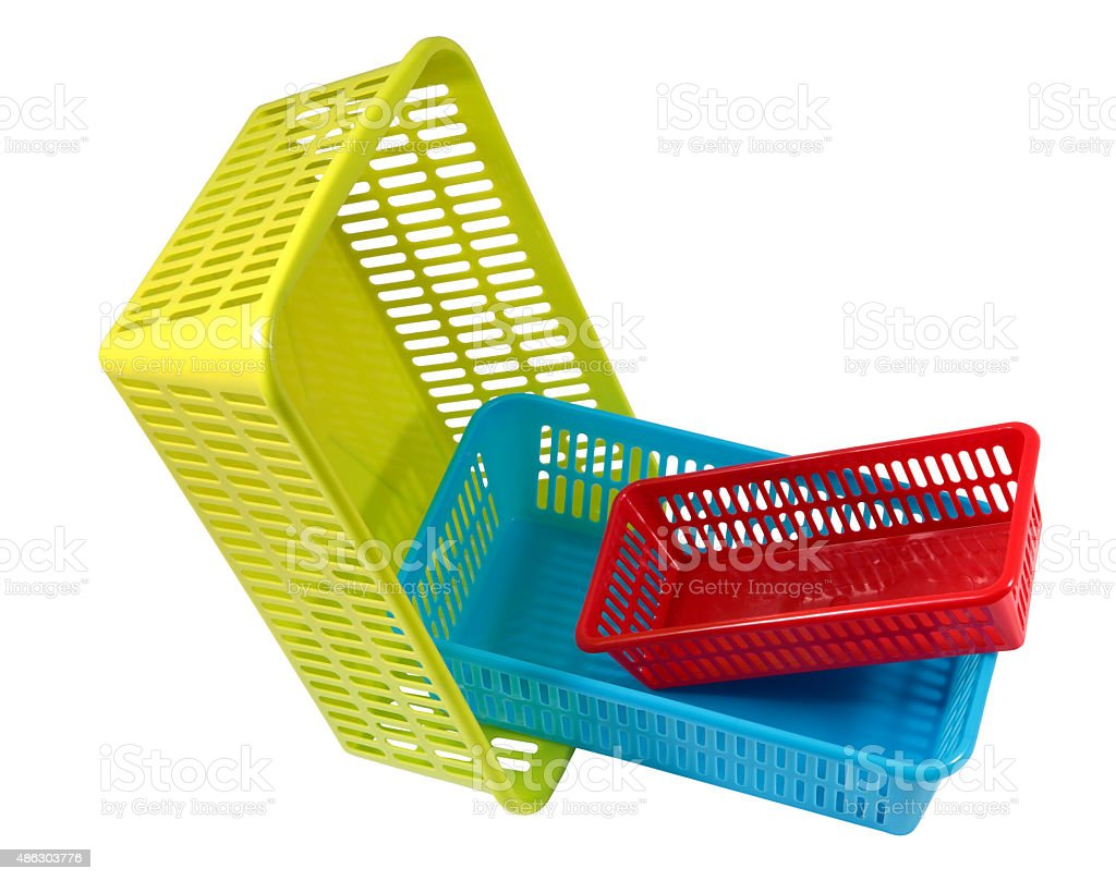 Household storage system, set colored plastic baskets of various sizes. stock photo