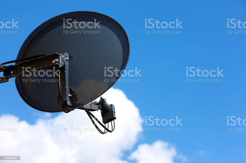 Household television Satellite Dish against a blue sky backgroundv royalty-free stock photo