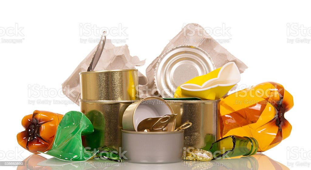 Household waste: plastic, glass bottles, cans and cardboard on white. stock photo