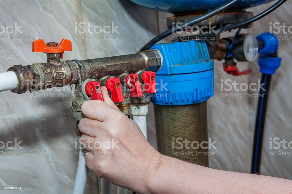 Household water supply unit, valves blocking access to pipes. stock photo