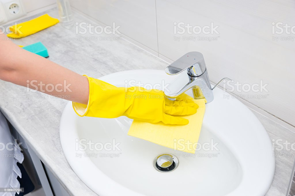 Housekeeper or housewife cleaning a bathroom stock photo