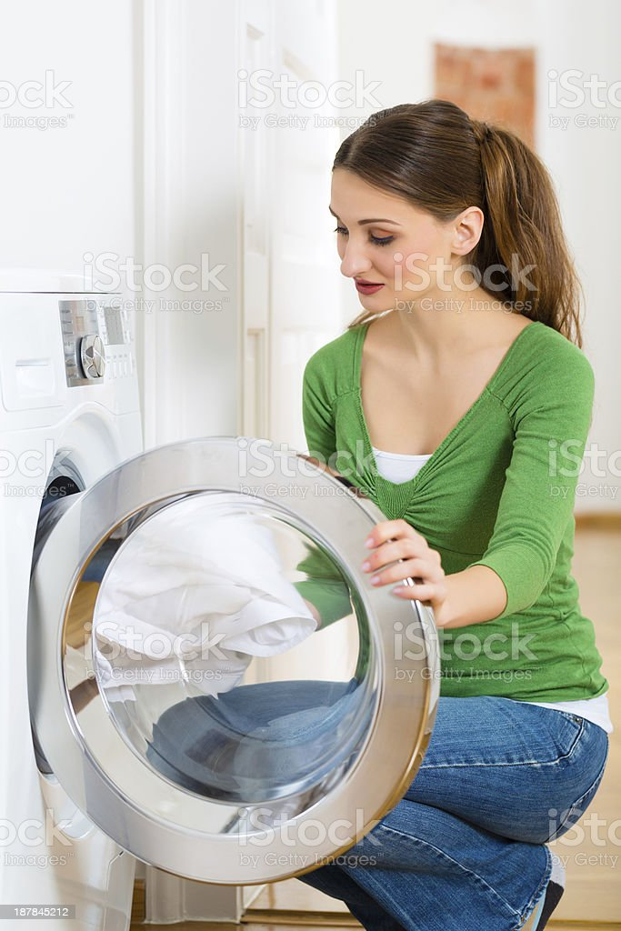 Housekeeper with washing machine royalty-free stock photo