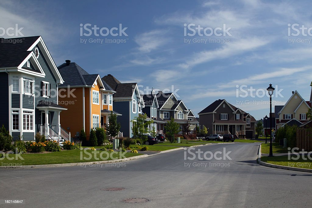 Houses align a residential district under a bright blue sky royalty-free stock photo