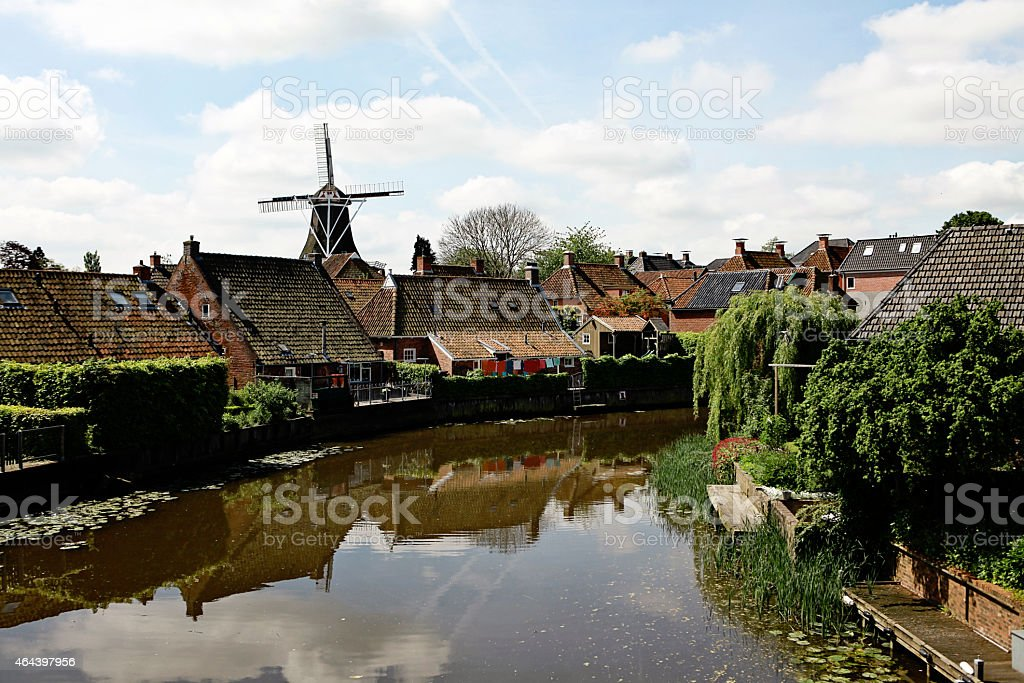 Houses and a Windmill in the Netherlands stock photo