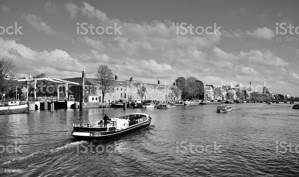 Houses and Boats on Amsterdam Canal stock photo