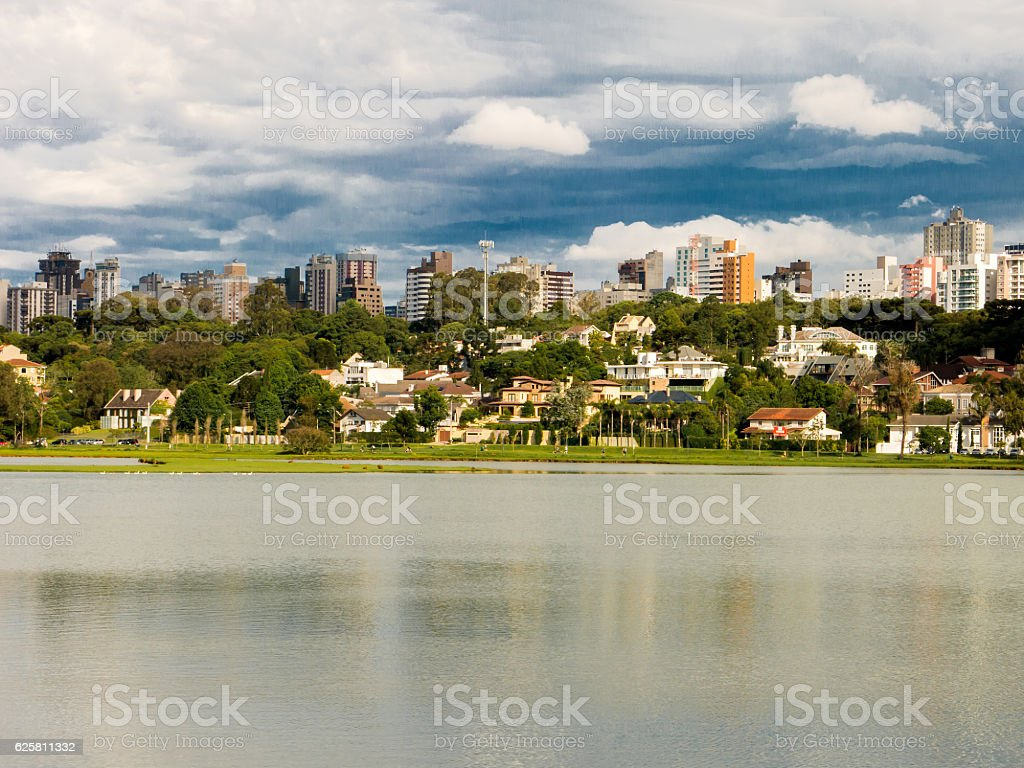 Houses and lake in Barigui park in Curitiba Parana Brazil stock photo