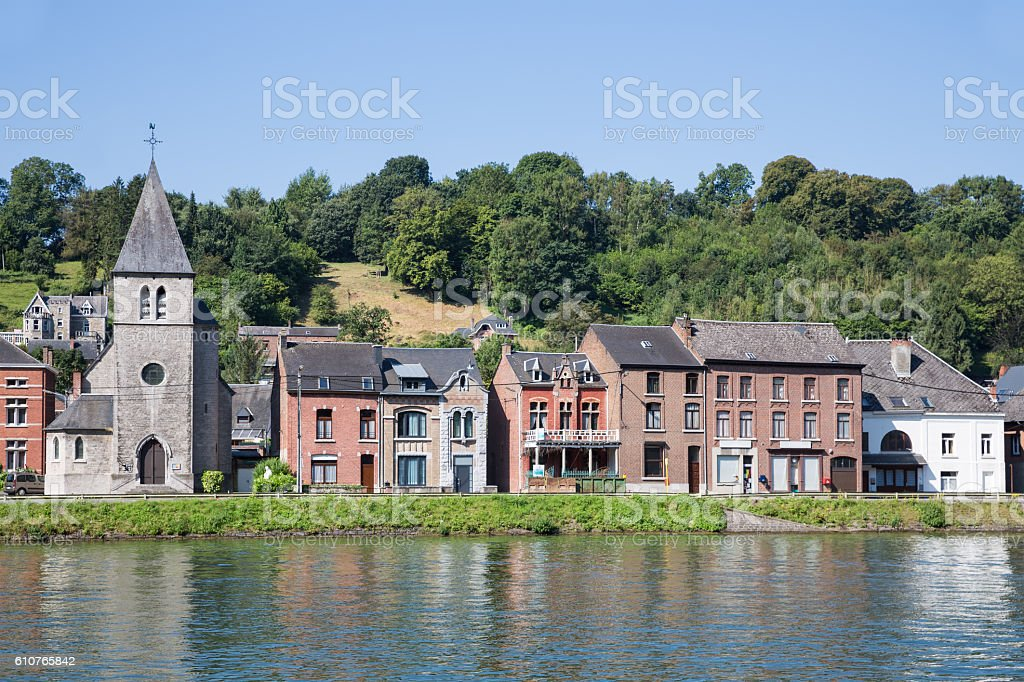 Houses and little church along Meuse river in Dinant, Belgium stock photo