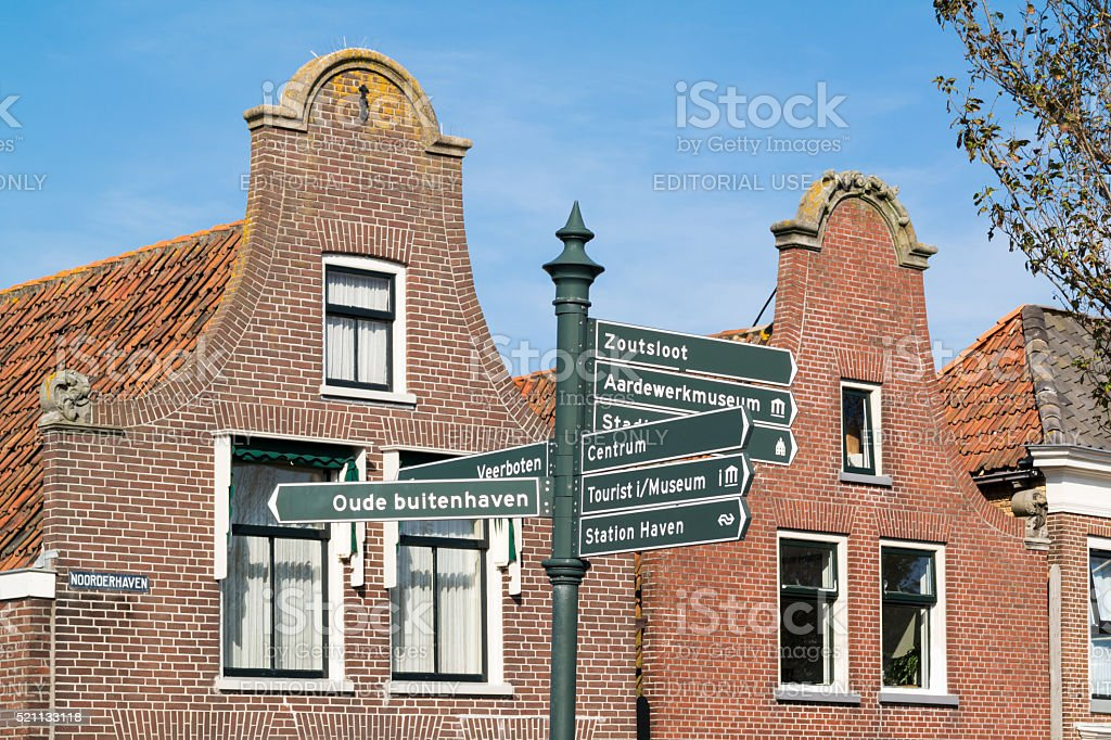 Houses and signpost in old town of Harlingen, Netherlands stock photo