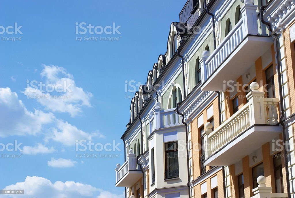 houses and sky with clouds stock photo