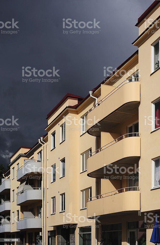 Houses / apartments with balconies, dramatic sky royalty-free stock photo