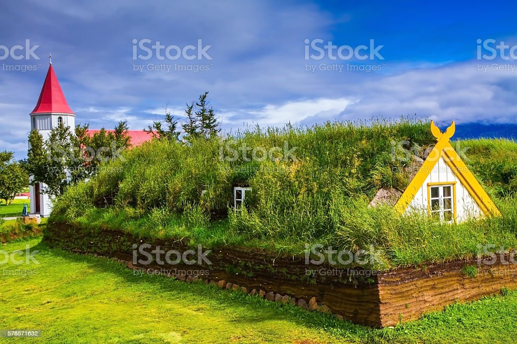Houses are roofed by the turf and grass stock photo