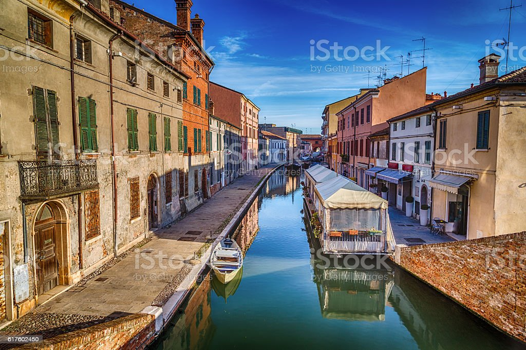 houses, bridges and water canals in lagoon village stock photo