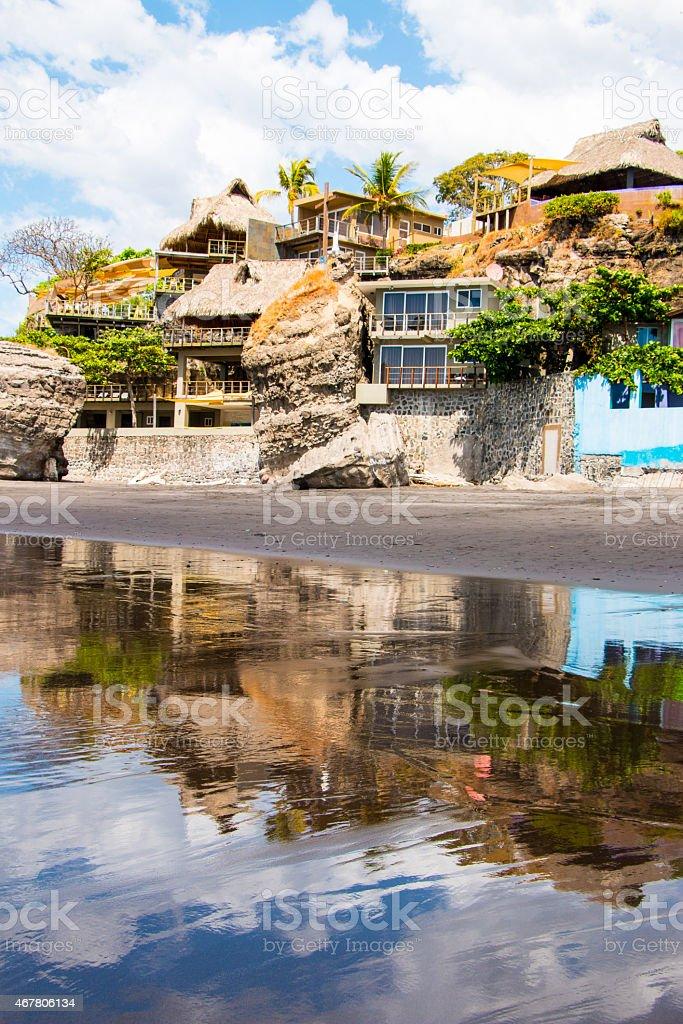 Houses built in rock at Playa El Tunco, El Salvador stock photo
