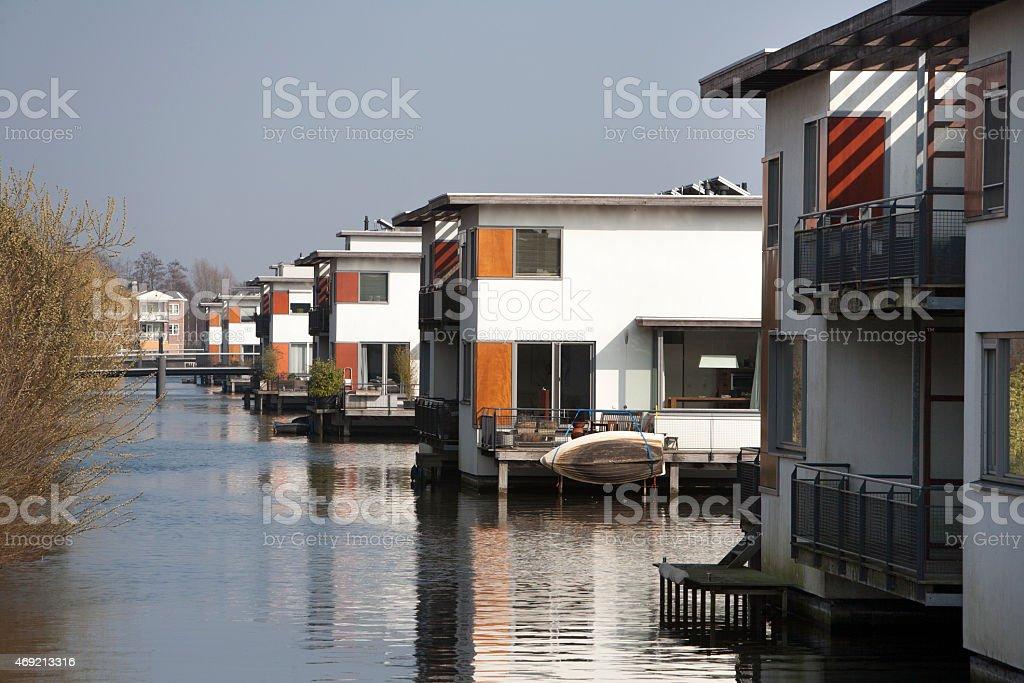 Houses built in water in quiet neighborhood stock photo