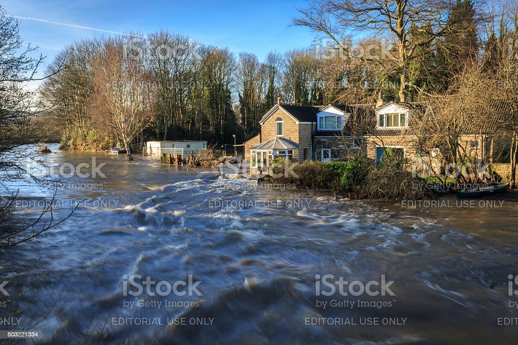 Houses by the river Aire in Leeds during a flood stock photo