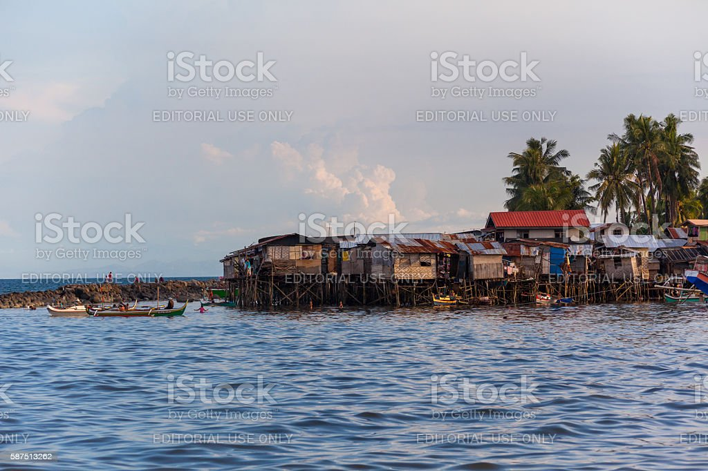 Houses by the sea in Davao, Philippines stock photo